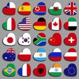 Fastställda bästa flaggor i formen av en hjärta, på en vinkel royaltyfri bild