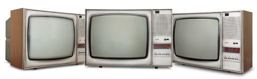 Fastställda gamla tv:ar på vit Arkivfoto