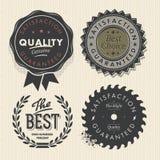 Fastställda högvärdiga kvalitets- för tappning och garantietiketter Royaltyfria Bilder