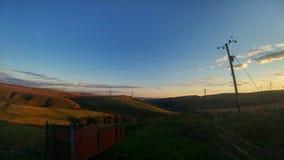 Fastställda kullar för sol av warland Royaltyfri Fotografi