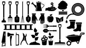 Fastställda svarta trädgårds- hjälpmedel Royaltyfri Bild