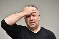 Fat Adult Male And Stress. An overweight and adult male Stock Photos
