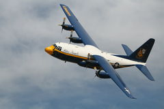 Fat Albert Flyby. Blue Angels Fat Albert doing a flyby against clouds. C-130 Hercules with Rocket-Assisted Take Off. Photo taken at Grand Junction CO Royalty Free Stock Photos