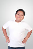 Fat Asian Boy Smiling Happily. Portrait of fat Asian boy wearing white shirt smiling happily Royalty Free Stock Photo