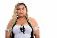 Fat Asian cleaning lady wearing maid costume. Isolated against white background stock images