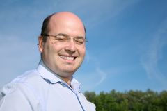 Fat bald man Stock Photo
