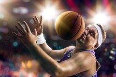 Fat Basketball non professional player catch the balln. Fat Basketball non professional player catch the ball. Bokeh background Royalty Free Stock Photo