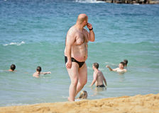 Fat beach man Royalty Free Stock Images