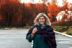 Fat beautiful girl outside in autumn stock photo