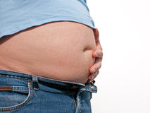 Fat Belly. Fat Beer Belly, short t-shirt and opened jeans Stock Images