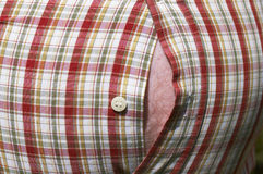Fat belly and stripes. Close up of tight shirt over a fat belly royalty free stock photo