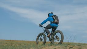 Fat bike also called fatbike or fat-tire bike in summer driving the hills. Fat bike also called fatbike or fat-tire bike in summer driving through the hills royalty free stock photos