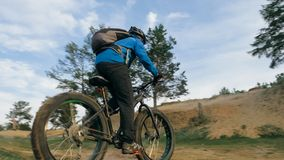 Fat bike also called fatbike or fat-tire bike in summer driving the hills. Fat bike also called fatbike or fat-tire bike in summer driving through the hills Stock Images