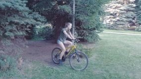 Fat bike also called fatbike or fat-tire bike in summer riding in the forest. Beautiful girl and her bicycle in the stock video footage