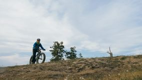 Fat bike also called fatbike or fat-tire bike in summer driving the hills. Fat bike also called fatbike or fat-tire bike in summer driving through the hills royalty free stock images