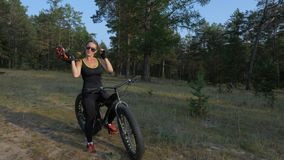 Fat bike also called fatbike or fat-tire bike in summer riding in the forest.