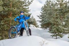 Fat bike. Fat tire bike. A young man riding fat bicycle in the winter. A young man riding fat bicycle in the winter. winter biking. Fatbike. Fat tire bike stock images