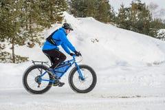 Fat bike. Fat tire bike. A young man riding fat bicycle in the winter. A young man riding fat bicycle in the winter. winter biking. Fatbike. Fat tire bike stock photos