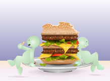 Fat boy eating a big hamburger Royalty Free Stock Image