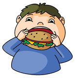 Fat Boy eats burger Royalty Free Stock Photography