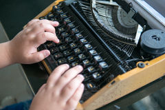 Fat Boy hands writing on old typewriter Stock Photo