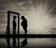 Fat boy and his reflection in mirror of a normal boy against the sky Stock Images