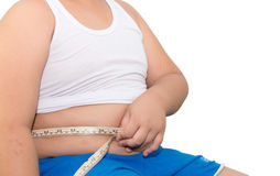 Fat boy measuring his belly with measurement tape isolated Royalty Free Stock Photography