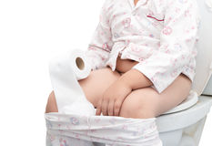 Fat boy sitting on the toilet isolated Royalty Free Stock Photography