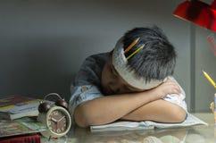 Fat boy sleep on book. Fat boy sleep on book on night Royalty Free Stock Image