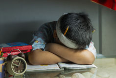 Fat boy sleep on book. Fat boy sleep on book on night Stock Photography