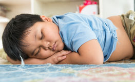 Fat boy sleep on his arm. Stock Image