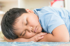 Fat boy sleep on his arm. Stock Photo