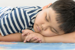 Fat boy sleep on his arm Royalty Free Stock Images