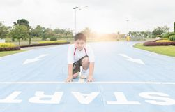 Fat boy in starting position ready for running. Royalty Free Stock Images