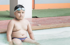 Fat boy on swimsuit Royalty Free Stock Image