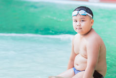 Fat boy on swimsuit Royalty Free Stock Photography
