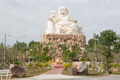 Fat Buddha. Sitting Buddha in city garden in Vung Tau, Vietnam Stock Photo