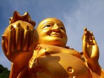 Fat Buddha ,Buddha Smiling. Buddha with gold bag Stock Images
