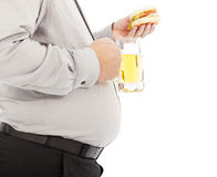 Fat business man holding beer mug and hamburger Royalty Free Stock Images