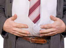 Fat businessman. Look at abdomen of fat businessman Royalty Free Stock Photography