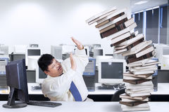Fat businessman having many tasks Stock Photography