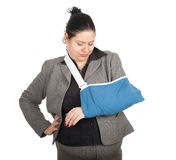 Fat businesswoman with broken hand Stock Photo