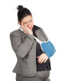 Fat businesswoman with broken hand Royalty Free Stock Photo