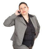 Fat businesswoman with mobil phone Royalty Free Stock Images