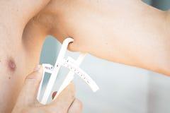 Fat caliper measuring bodyfat Royalty Free Stock Photos
