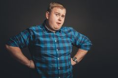 Fat caucasian man thinking and looking up to copyspace. Portrait of Fat caucasian man thinking and looking up to copyspace Stock Image