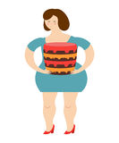 Fat cheerful woman and cake. Joy of eating. Stock Image