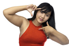 Fat Chubby Girl. Fat asian chubby girl framing her face isolated over white background Royalty Free Stock Photos