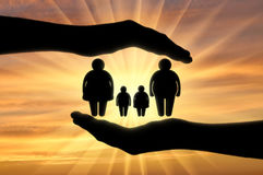 Fat family in the hands of man. Help fat people. Fat family in the hands of man royalty free stock photo