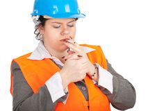 Fat female architect or engineer with cigarette Royalty Free Stock Photography